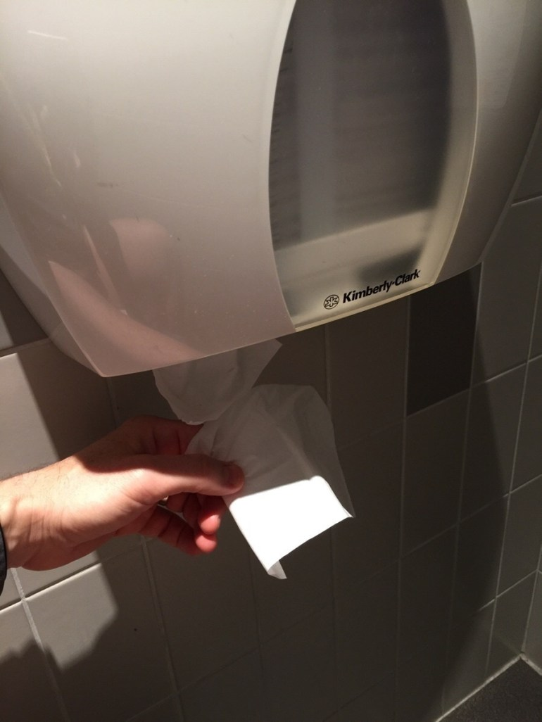 A machine that dispense individual sheets of toilet paper.