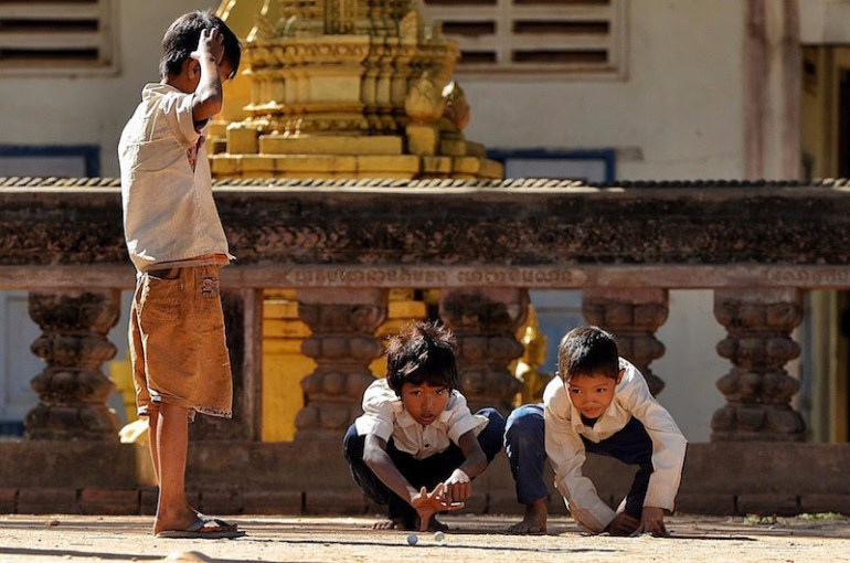 """""""Boys playing marbles in Cambodia"""" Cambodia"""