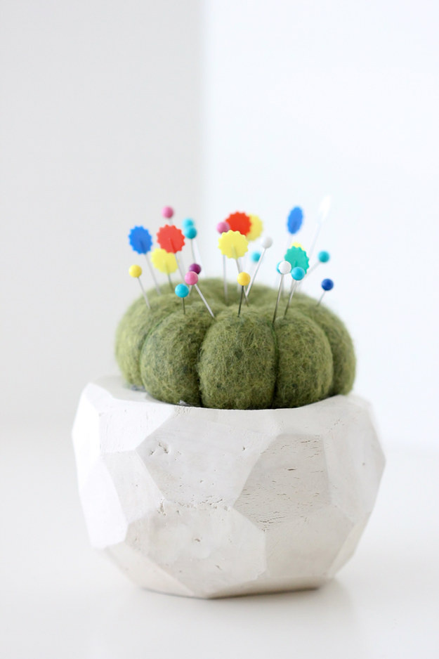 Create a fake cactus pin cushion to hold your needles and pins.