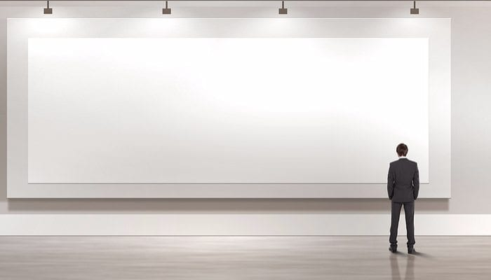 Man infront of empty advertising