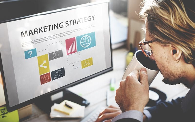 Business Man looking at Marketing Strategies