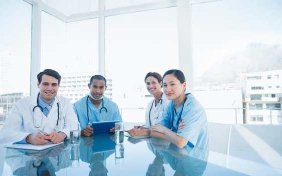 Healthcare professionals sitting at a table studying color theory