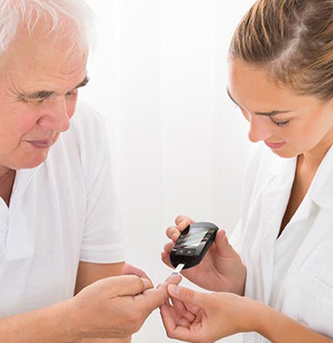 Nurse assistant testing elder patient