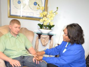 Natural Health Practitioner Assessing and Consulting with a Client