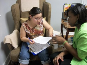 Ayana Assisting A Client