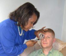 Natural Health Practitioner performing iridology exam