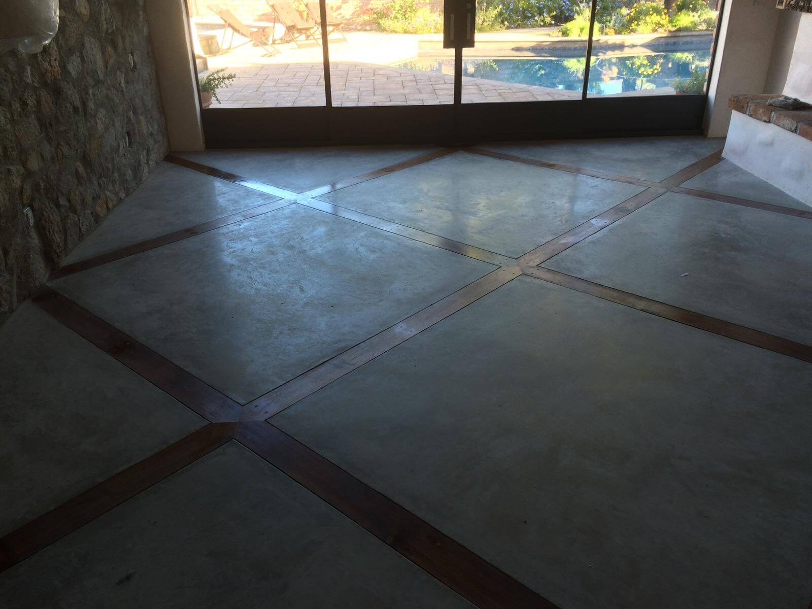 Polished Concrete House Floors With Decorative Wood Inlay