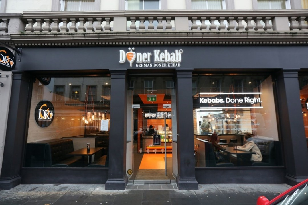 The welcoming and clean exterior of a German Doner Kebab Restaurant
