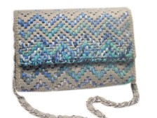 Embroidered shoulder bag with chain