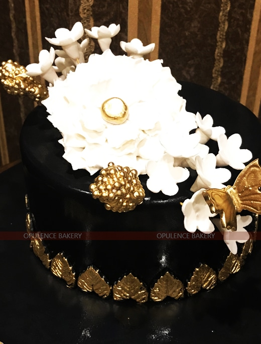 elegant white golden black cake