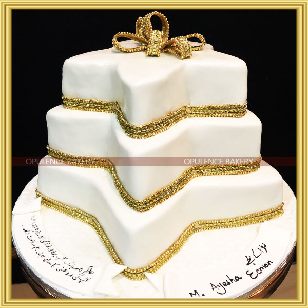 white and gold cake for girls
