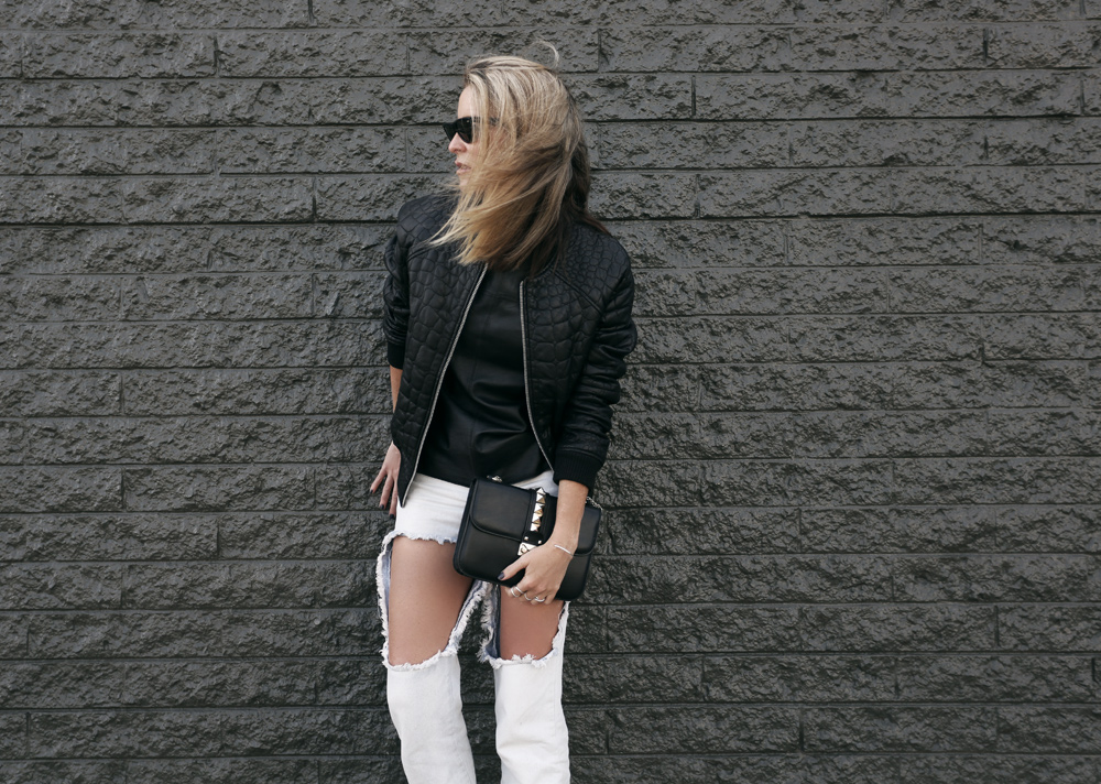 Distressed denim jeans black leather bomber mode collective heels valentino rockstud rock stud bag clutch ray ban sunglasses