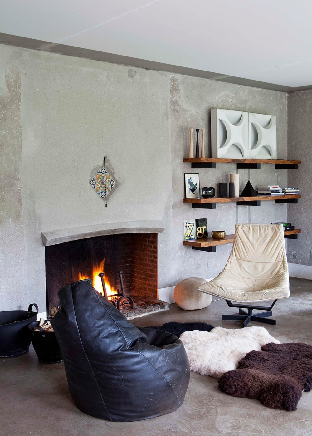 Oracle, Fox, Sunday, Sanctuary, Extracurricular, Bea, Members, Hotel, Belgium, Industrial, Style, Interior, Designer, White, Concrete, Living Room, Black Leather Couch, Fireplace