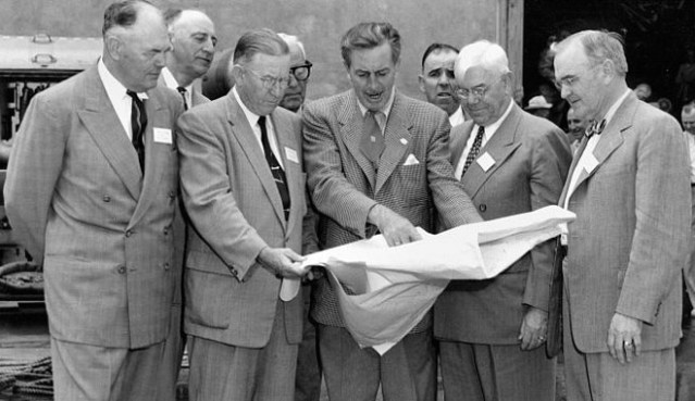 Walt Disney shows his plans to Anaheim officials.
