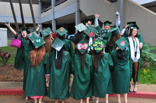 STUDENTS at the University of Hawaii graduating (UH photo).