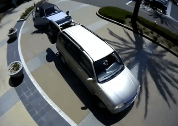 CAR at top is driven toward the victim during a carjacking in Huntington Beach Tuesday (HBPD image).