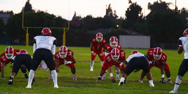GARDEN GROVE HIGH (in red uniforms) is rated sixth in the CIF-SS Division 8 football poll for this week (OC Tribune photo).