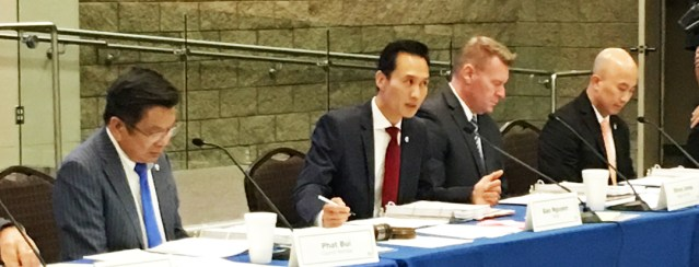 MAYOR BAO NGUYEN (center, red tie) speaks to the rest of the Garden Grove City Council Tuesday   night (OC Tribune photo).