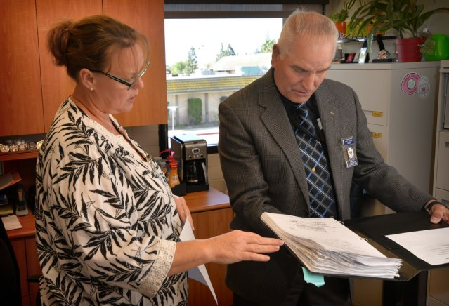 CAROLE Kanegae, department secretary for Garden Grove PD, shows Assessor Daniel Boring the records she keeps during an accreditation interview. (Photo by Steven Georges/Behind the Badge OC).