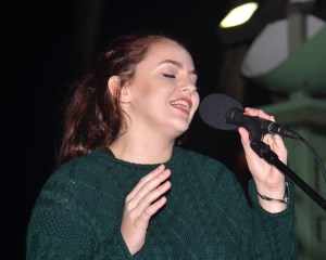 """KAYLA WENDT, winner of the 2016 """"Voice of Garden Grove"""" contest, sang at the tree-lighting event (OC Tribune photo)."""