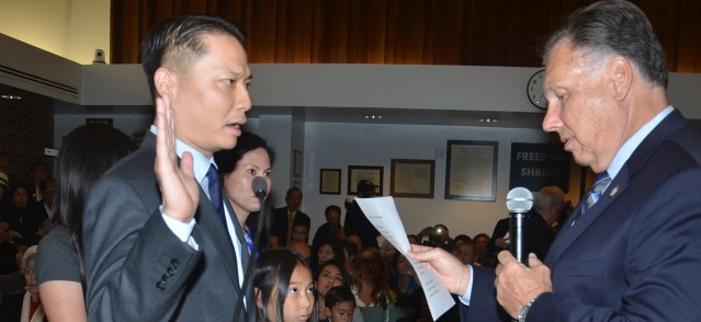 TRI TA was sworn in Tuesday night by Orange County District Attorney Tony Rackauckas for another term as mayor of Westminster (OC Tribune photo).