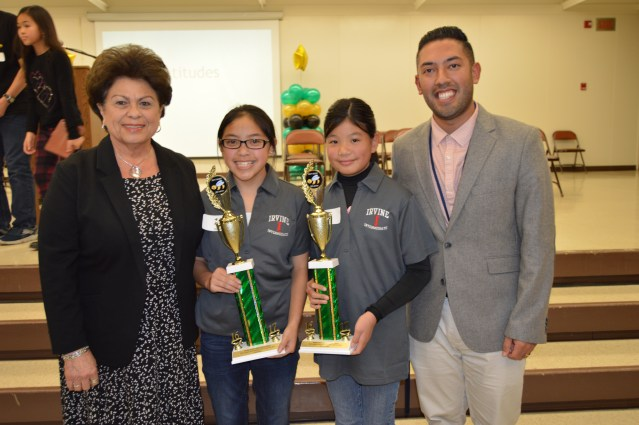 GARDEN GROVE Unified School District Board of Education trustees congratulate the top two spellers on their success in the district's 30th Annual Spelling Bee. From left: Trustee Teri Rocco, first place speller Genevie Nguyen, second place speller Tracy Nguyen, and Board of Education Trustee Walter Muneton (GGUSD photo).