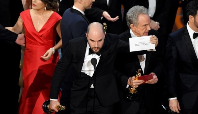 """WAIT, NO ... look, the card says """"Moonlight"""" for Best Picture (AMPAS photo)."""