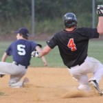 Teddy Ballou slides into second as the Stratford player drops the ball... and ... he's .... safe!