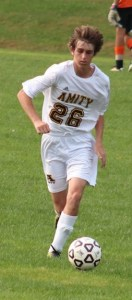 Amity Junior Natan Busel makes his way across the field.
