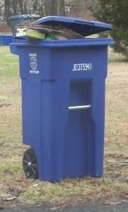 Full Recycling Bin in Orange