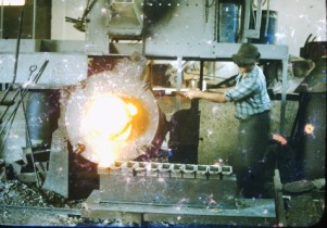 George Glucina (c.1960s) pouring bronze alloy ingots at his factory.