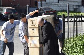 Moving the crate of panels to the Church.