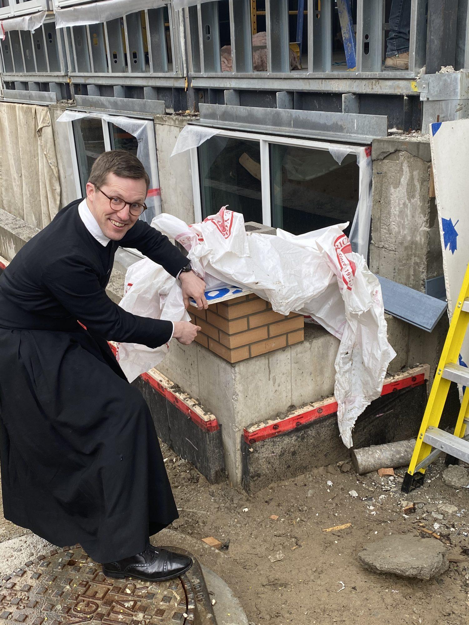 Fr Michael inspects the model bricks