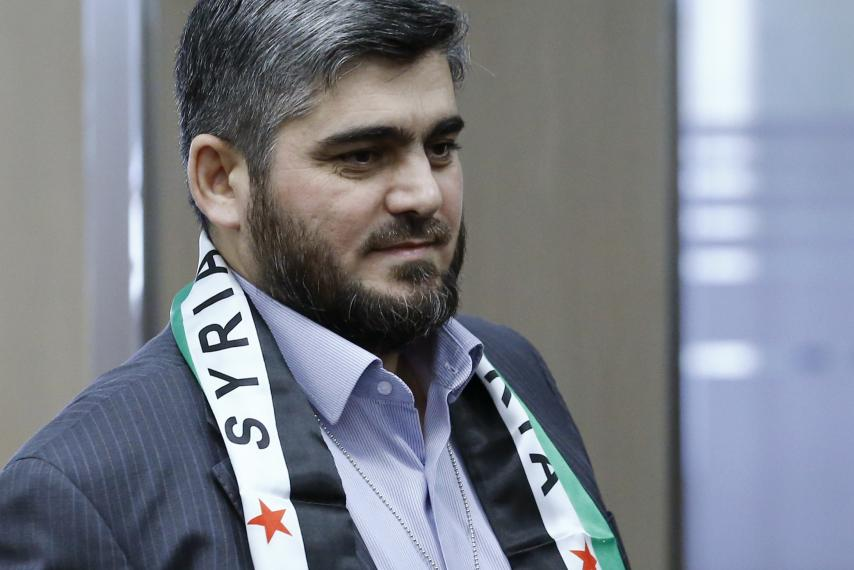 hnc-negotiator-mohammed-alloush-arrives-geneva.