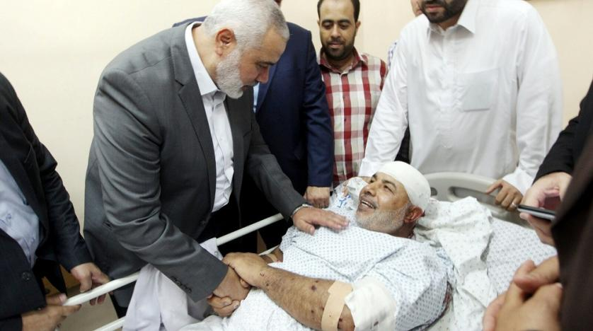 hamas_chief_ismail_haniyeh_visits_tawfiq_abu_naim_in_shifa_hospital_in_gaza_strip_on_friday._reuters