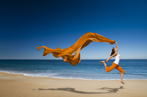 Woman Running On a Beach. Summer Deals from OrcaPack