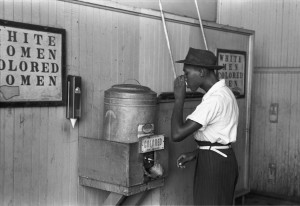 """Colored""_drinking_fountain_from_mid-20th_century_with_african-american_drinking"