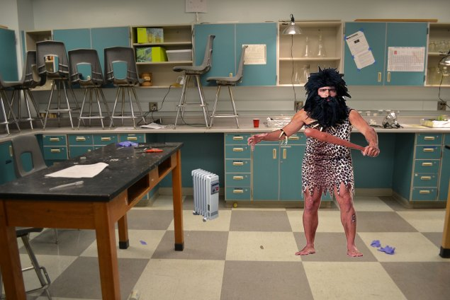 Alexander Jefferson IV (is caveman, duh) doing chemistry with club in science lab. OOGA BOOGA