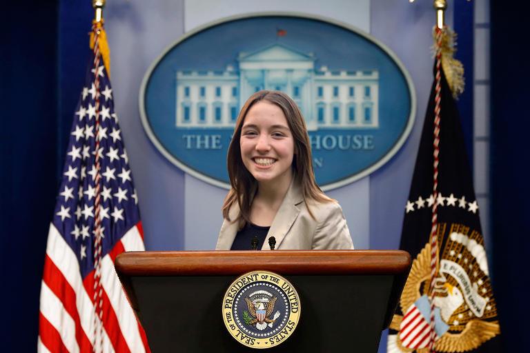 Thompson behind the presidential podium.