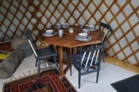 The dining area inside the yurt
