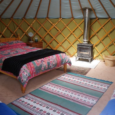 Inside Greengage Yurt you'll find a double bed and two single beds