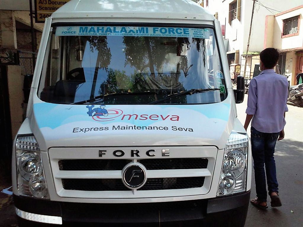 Front view of a tempo displaying MSeva company vehicle branding using printable air release media