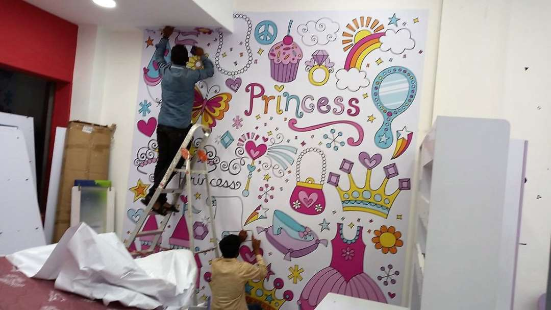 custom designed wallpaper being pasted on the wall