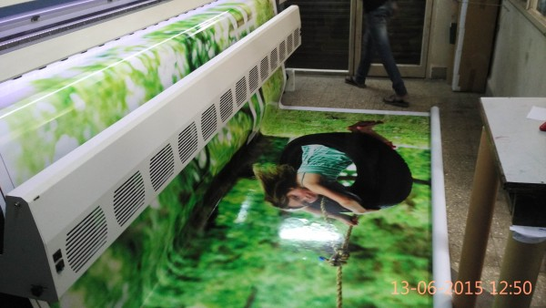 flex hoarding being printed on a wide format solvent inkjet printer