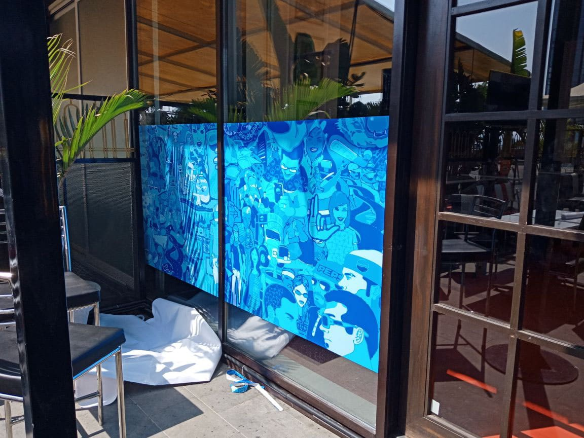 printed window decals for privacy using high resolution inkjet printed vinyl pasted on the front partition of a cafe