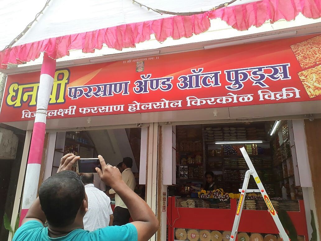 non lit printed flex banner stretched tightly on a metal frame for dhanlaxmi grocery store