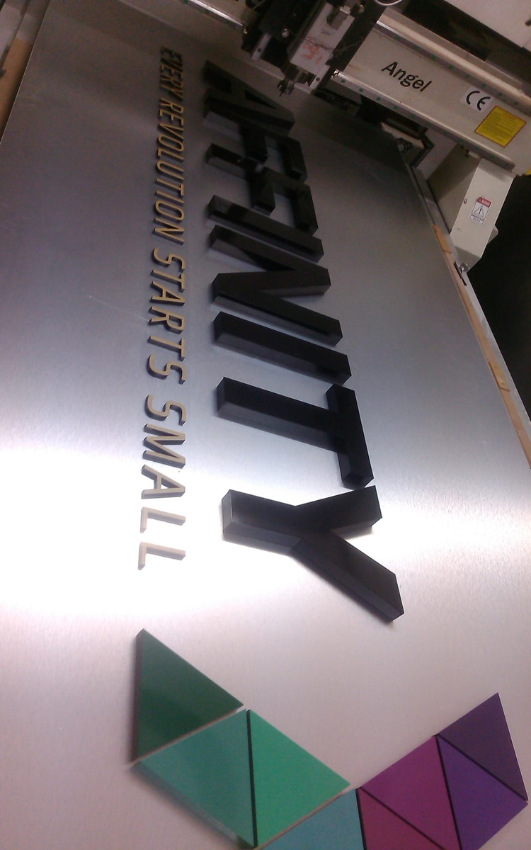 CNC routing of 3D acrylic company logo