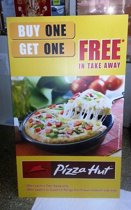 front view of a printed sunboard standee showing an ad for a Pizza Hut product