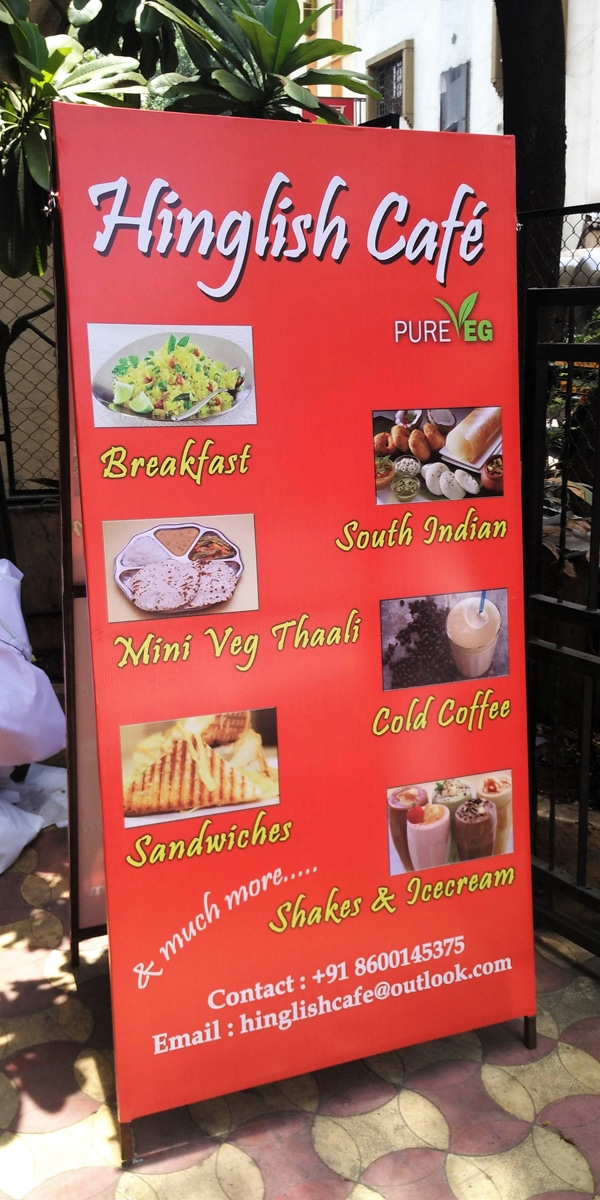 two sided flex stand showing food menu of hinglish cafe