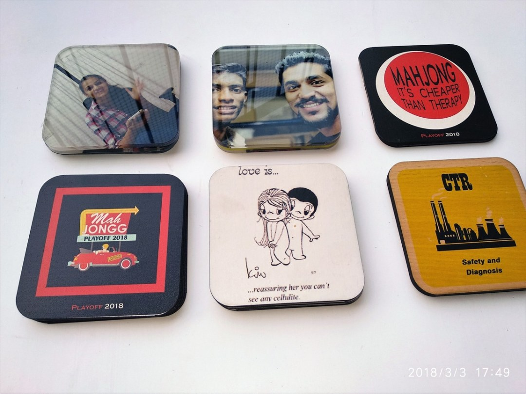 coasters having company logo printed on them